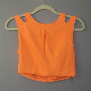 Orange crop top with cutouts